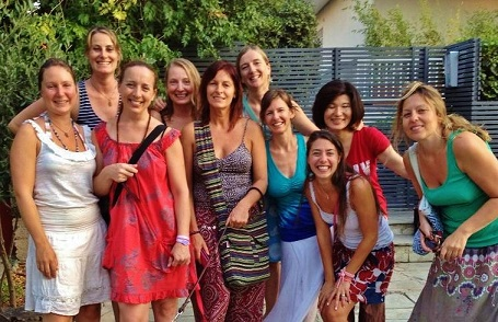 Athens Red Tent: All smiles after a monthly talking-stick sharing circle. The Red Tent community was international. There are 6 countries represented in this photo!