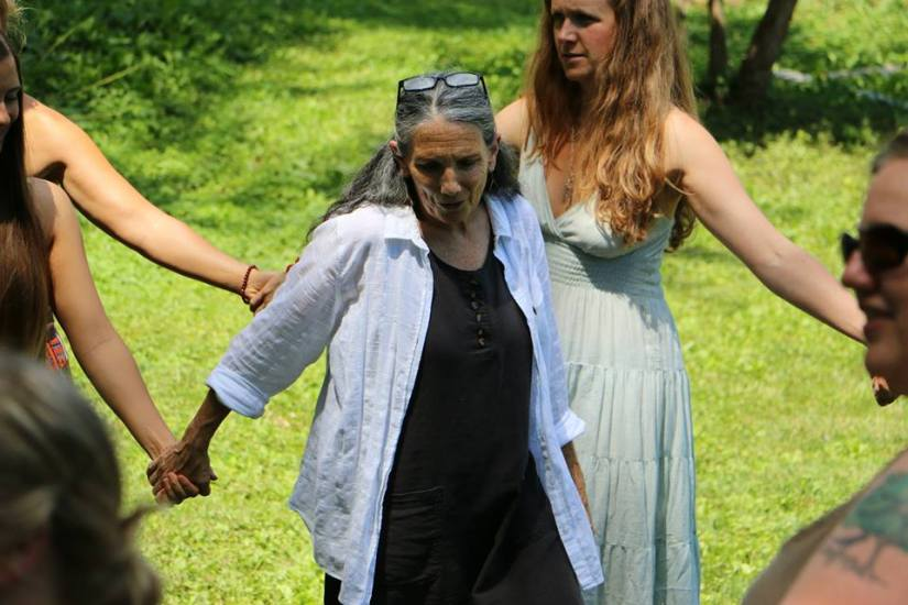 Red Tent Indy: Here is master herbalist Constance Ferry, owner of Hobbit Gardens, guiding the women through the blissfully spontaneous Spiral Dance. (photo courtesy of Red Tent Indy)